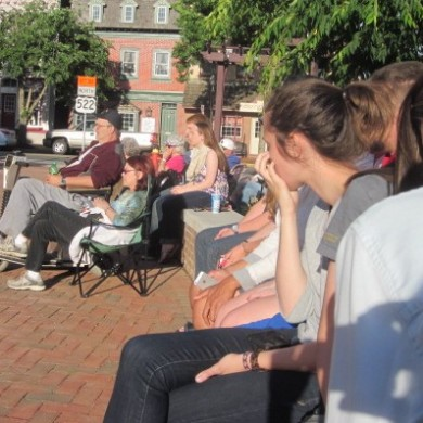 Close up of people sitting outside at Selinsgrove, PA Commons