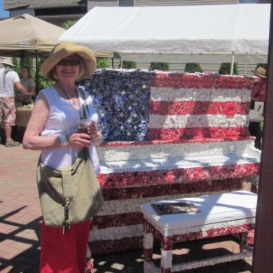 Lady standing by USA Flag Colored Piano Palooza 2014 Selinsgrove, PA