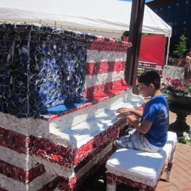 Little boy playing USA FLag colored Piano Palooza 2014 selinsgrove, PA