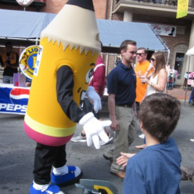 Pencil mascot about to shake little boys hands downtown Selinsgrove, PA event
