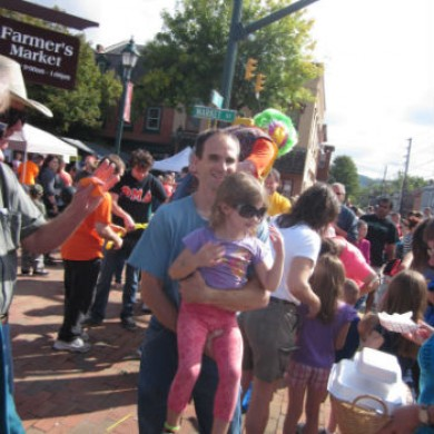 v fair lots of people crowded man holding girl Selinsgrove, PA